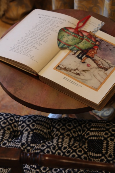 """My Grandmother's First Book...inscribed in her cursive """"First Book, Christmas 1916"""" it sits in my Living Room during this time of year near a Child Friendly Petit Bench so little ones feel welcome"""